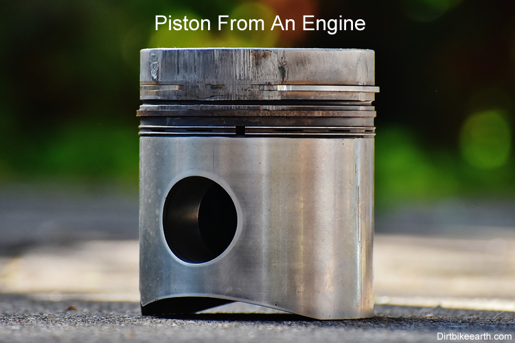Piston from two stroke engine